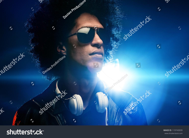 Cool nightclub party dj portrait with headphones lighting flare and sunglasses  sc 1 st  Shutterstock & Cool Nightclub Party Dj Portrait Headphones Stock Photo 119743039 ... azcodes.com