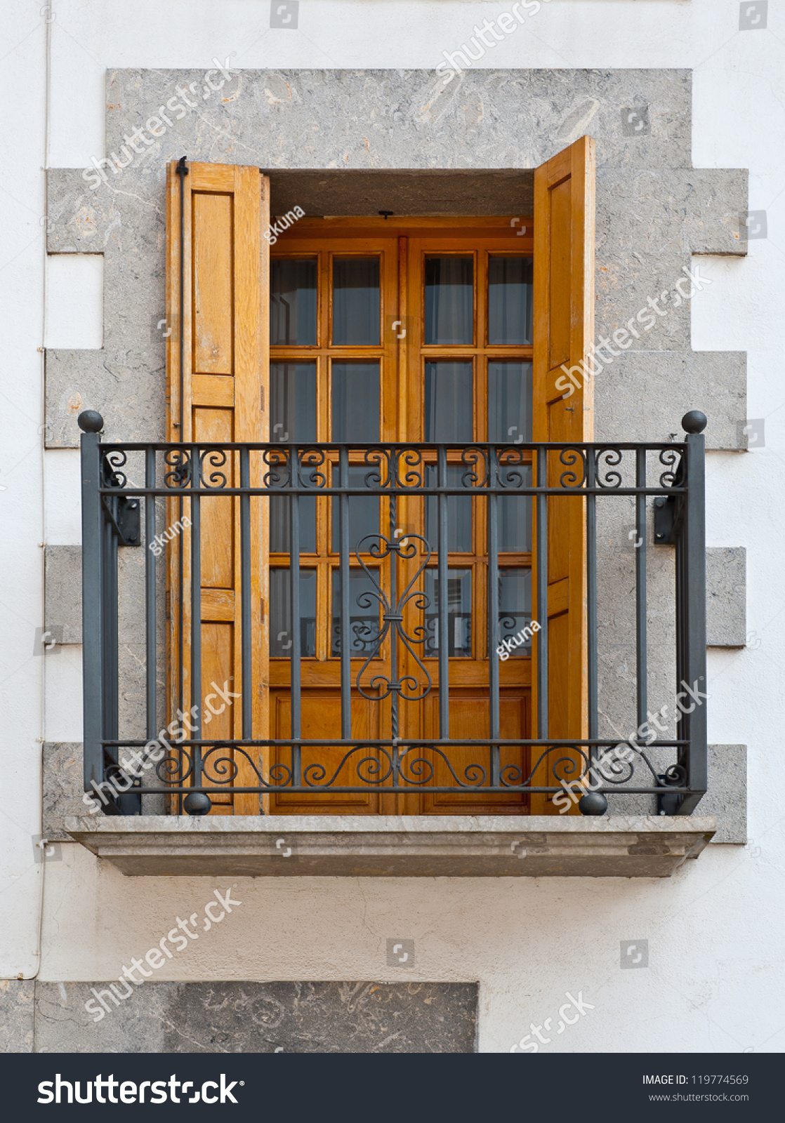The renovated facade of the old spanish house with balcony for Balcony in spanish
