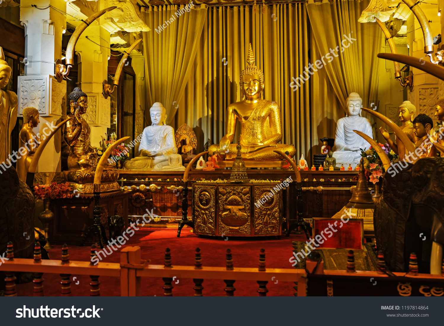 statues  in the tample Buddha's Tooth, Sri Lanka