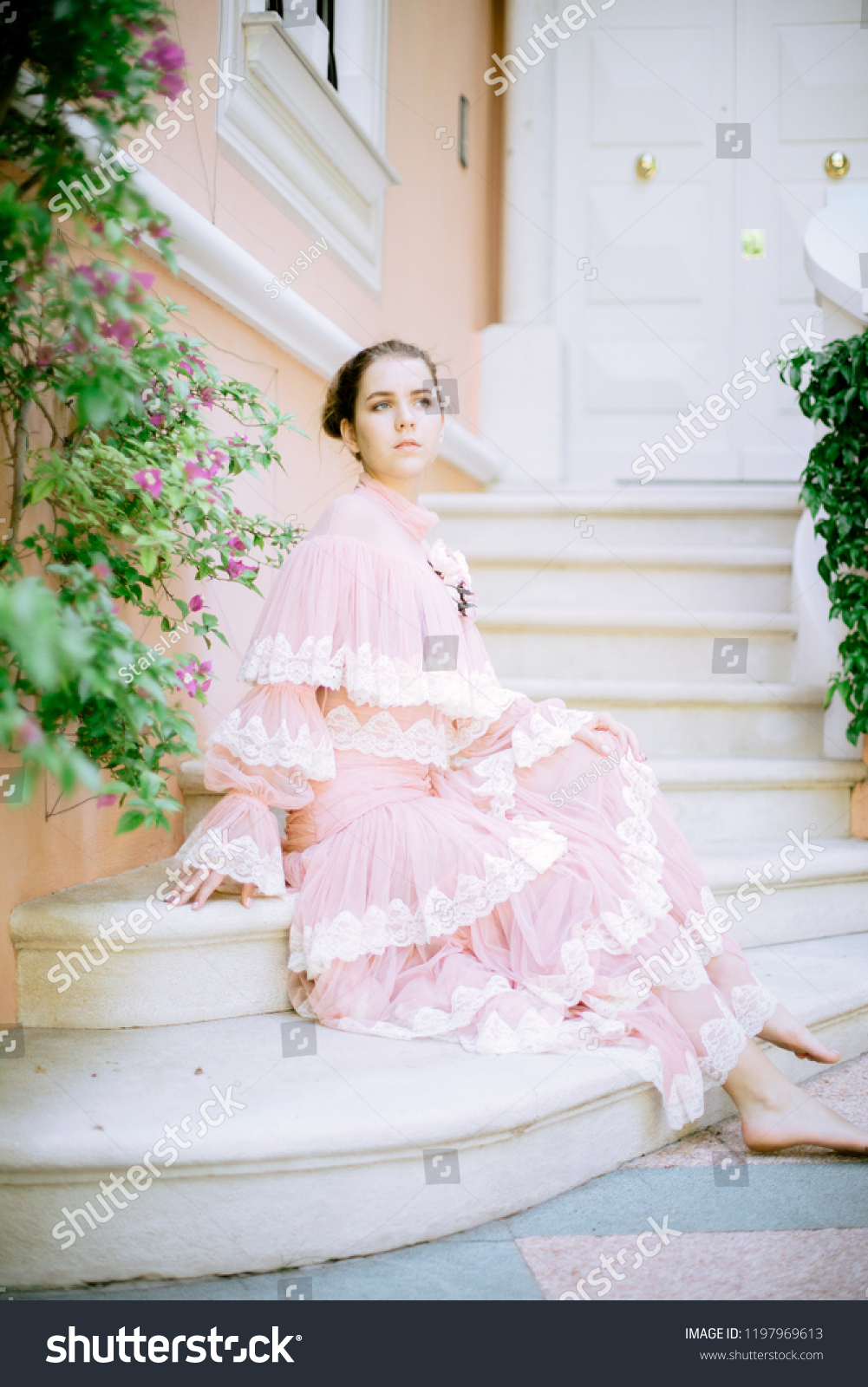 https://image.shutterstock.com/z/stock-photo-very-beautiful-young-girl-with-blond-hair-with-a-nominal-transparent-pink-dress-on-the-background-1197969613.jpg