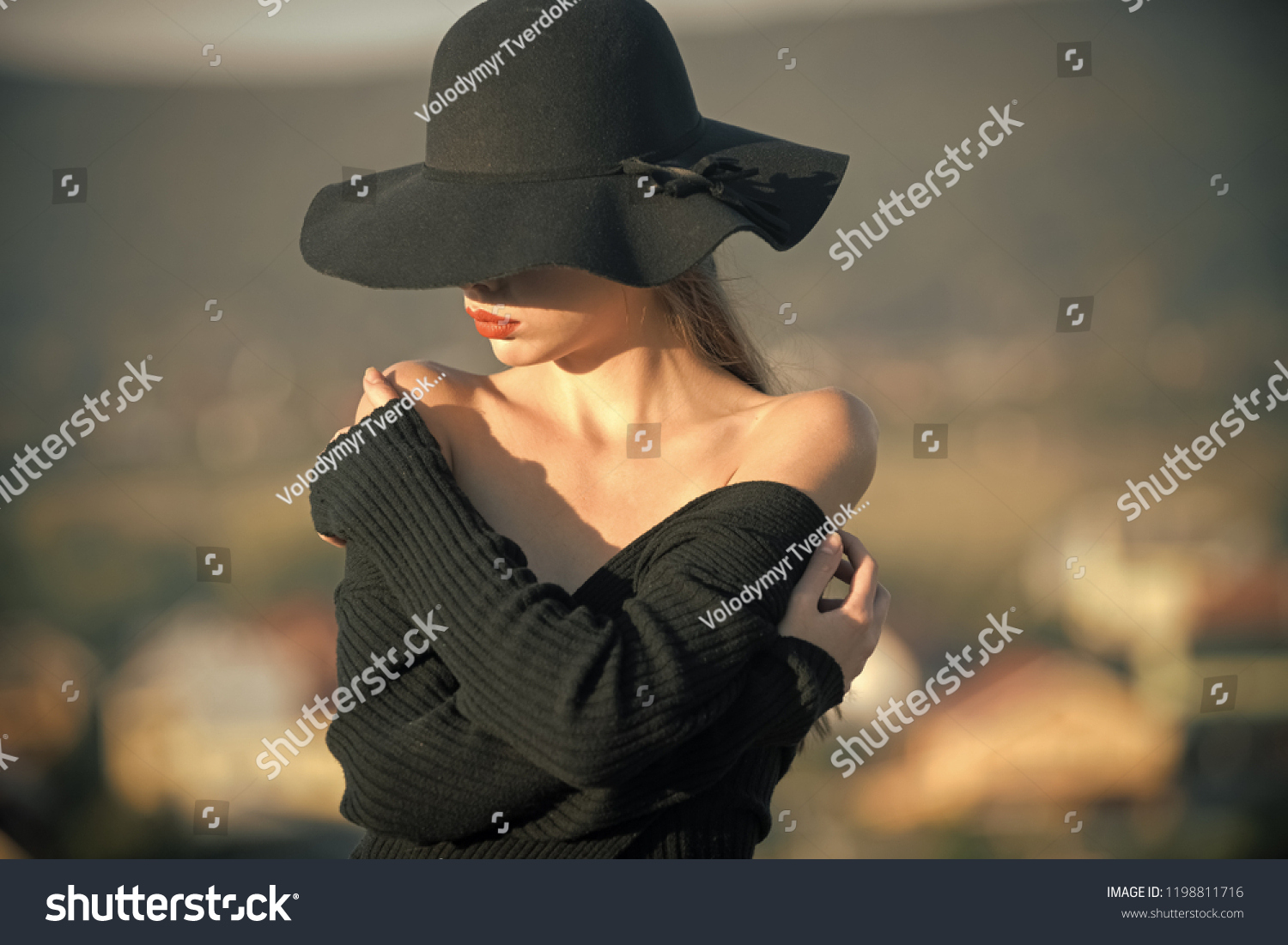 Beauty and fashion. beauty of pretty young woman in black hat #1198811716