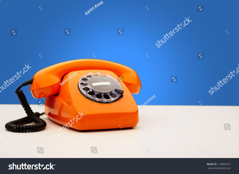 vintage orange telephone on blue background stock photo 119885437 shutterstock. Black Bedroom Furniture Sets. Home Design Ideas