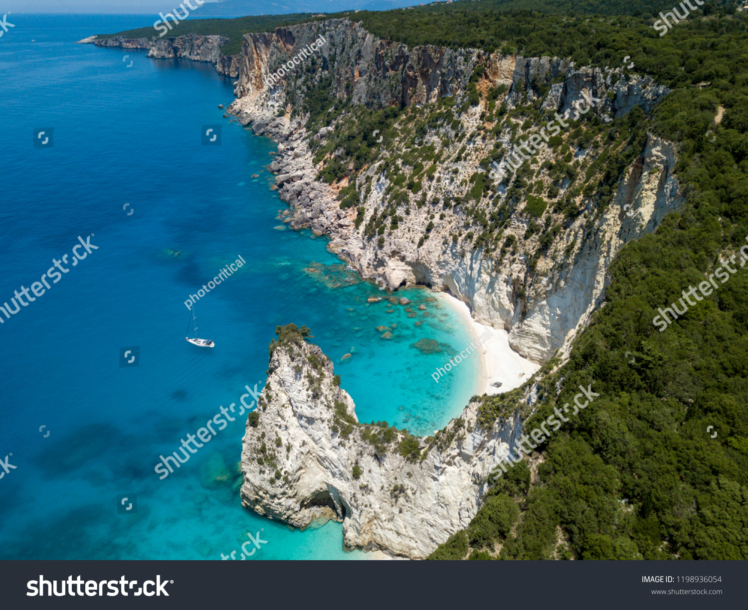 Aerial photo over greek island boat cliffs coastline landscape #1198936054