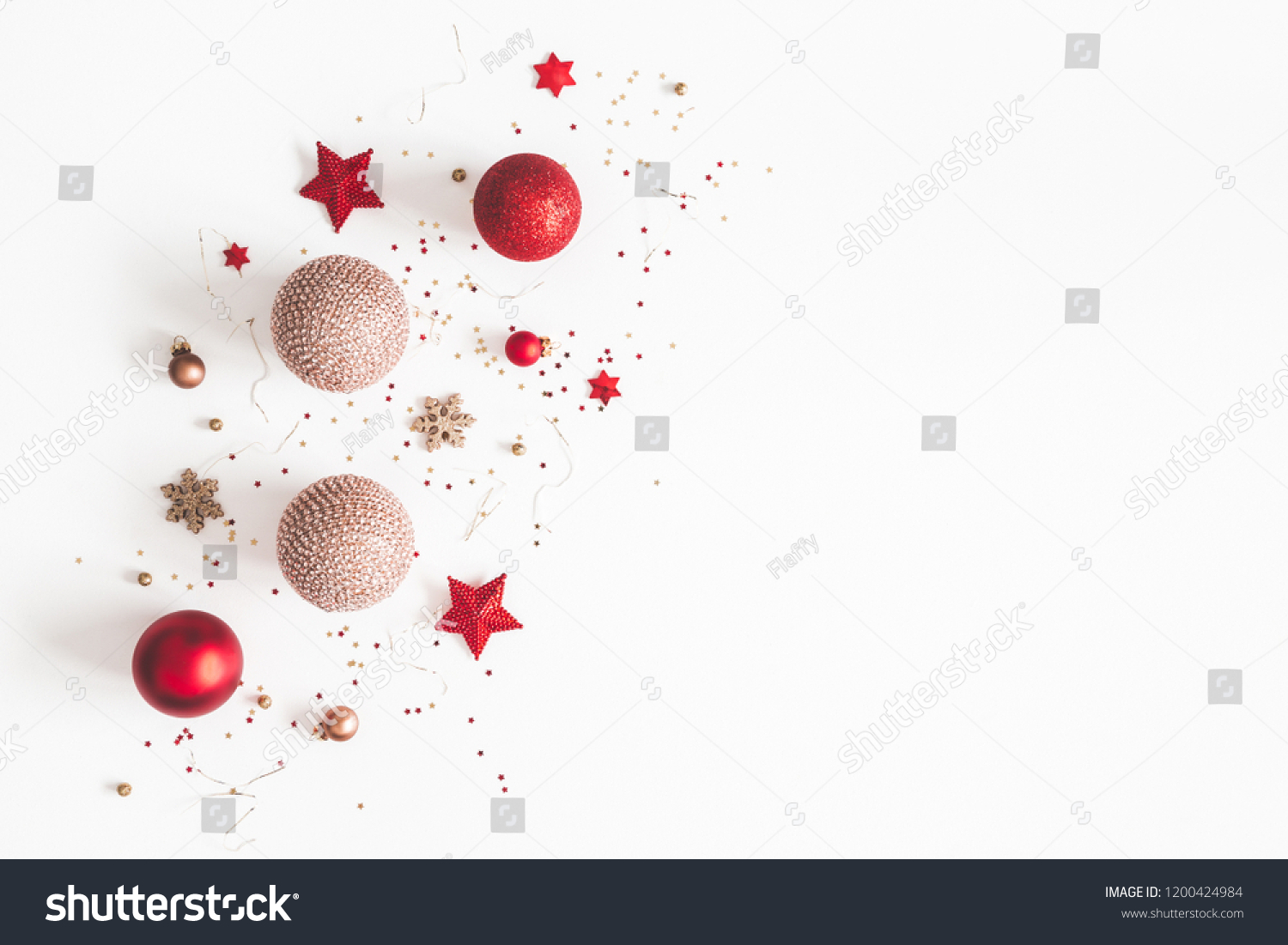 Christmas composition. Christmas red and golden decorations on white background. Flat lay, top view, copy space #1200424984