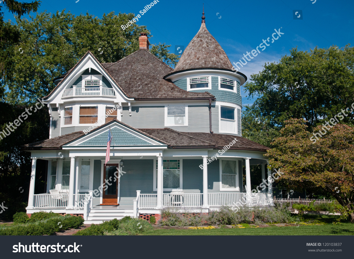 Beautiful gray traditional victorian house american stock for Victorian traditional homes