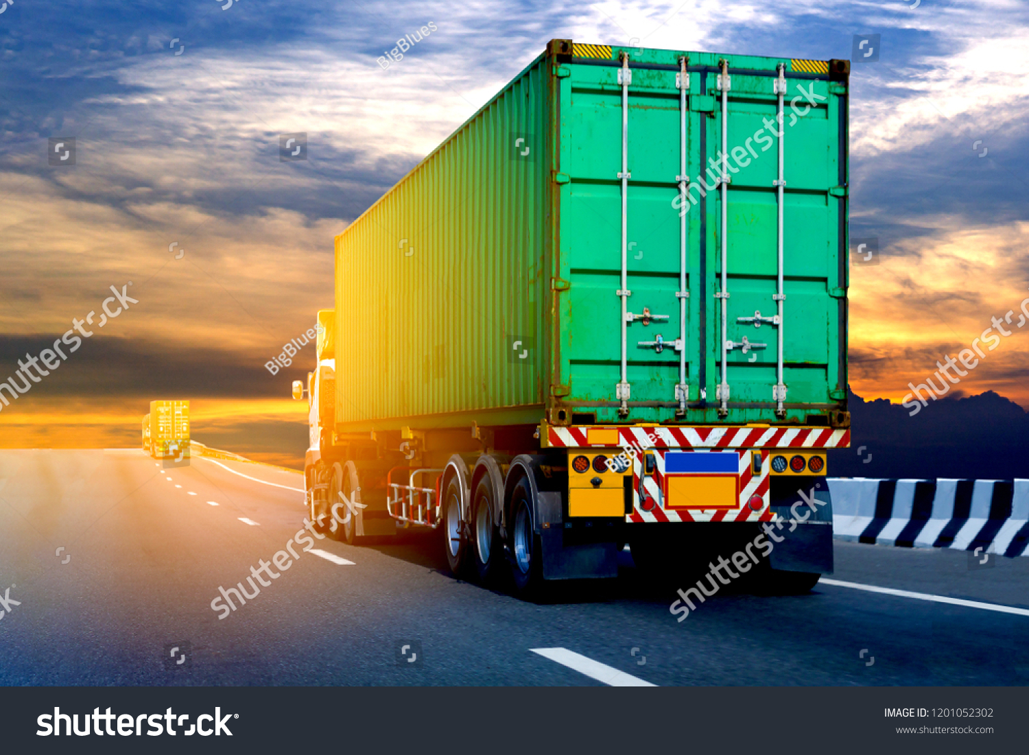 White Truck on highway road with green  container, transportation concept.,import,export logistic industrial Transporting Land transport on the asphalt expressway Against Sky During Sunset #1201052302