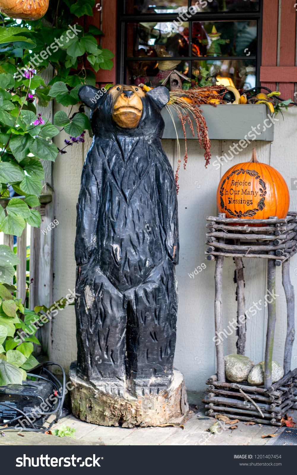 Chainsaw carved wood bear fall pumpkin stock photo edit now