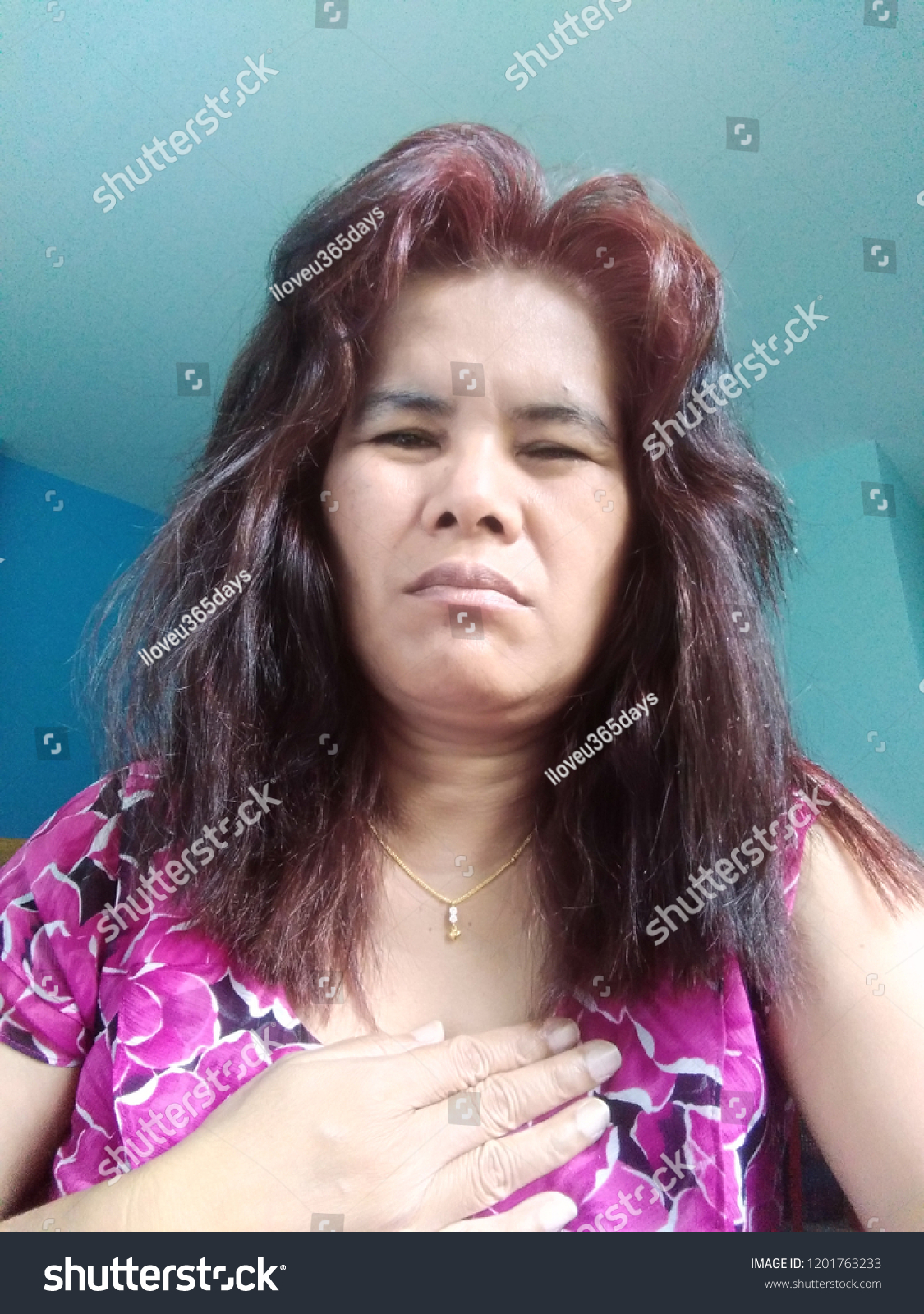 44fa0c5112 Stock photo red black hair asian woman touch her chest with hand because  she severe chest