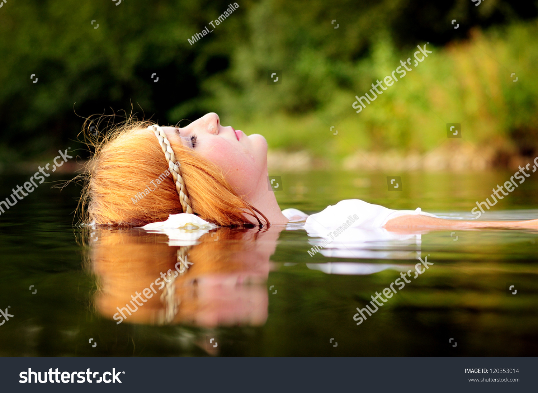Young girl relaxing in water