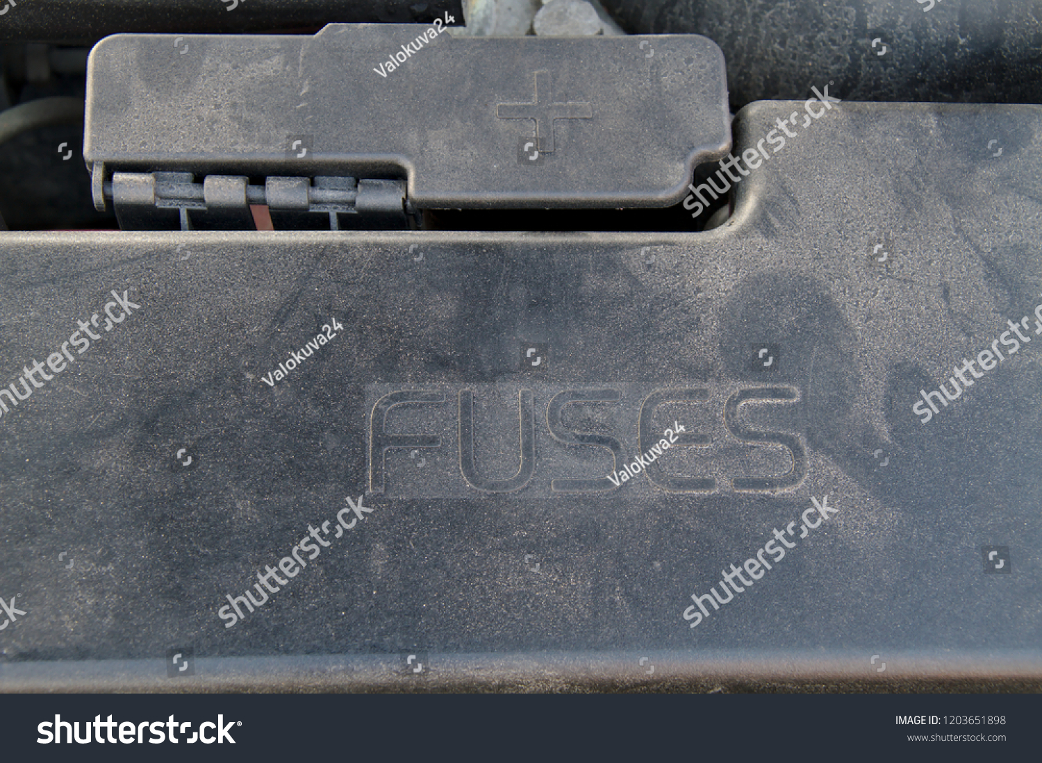 cover of a under hood fuse box of a car  external plus terminal for jumper