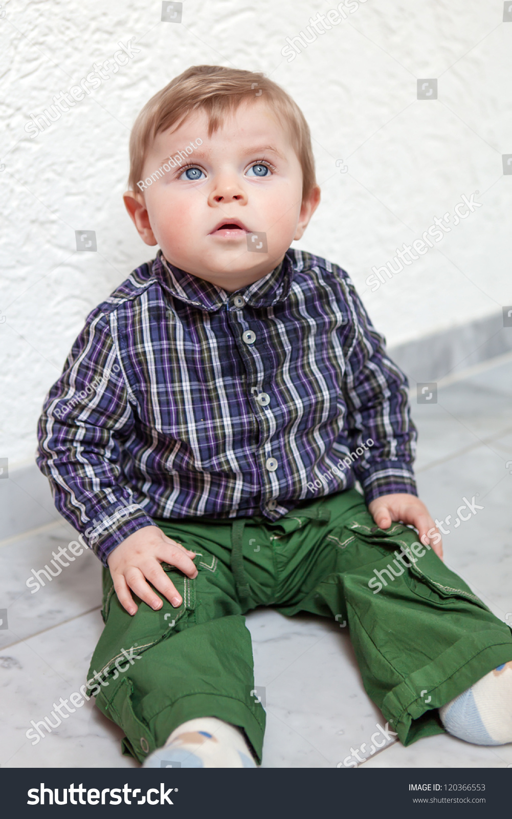 adorable toddler with blue eyes and blond hair indoor