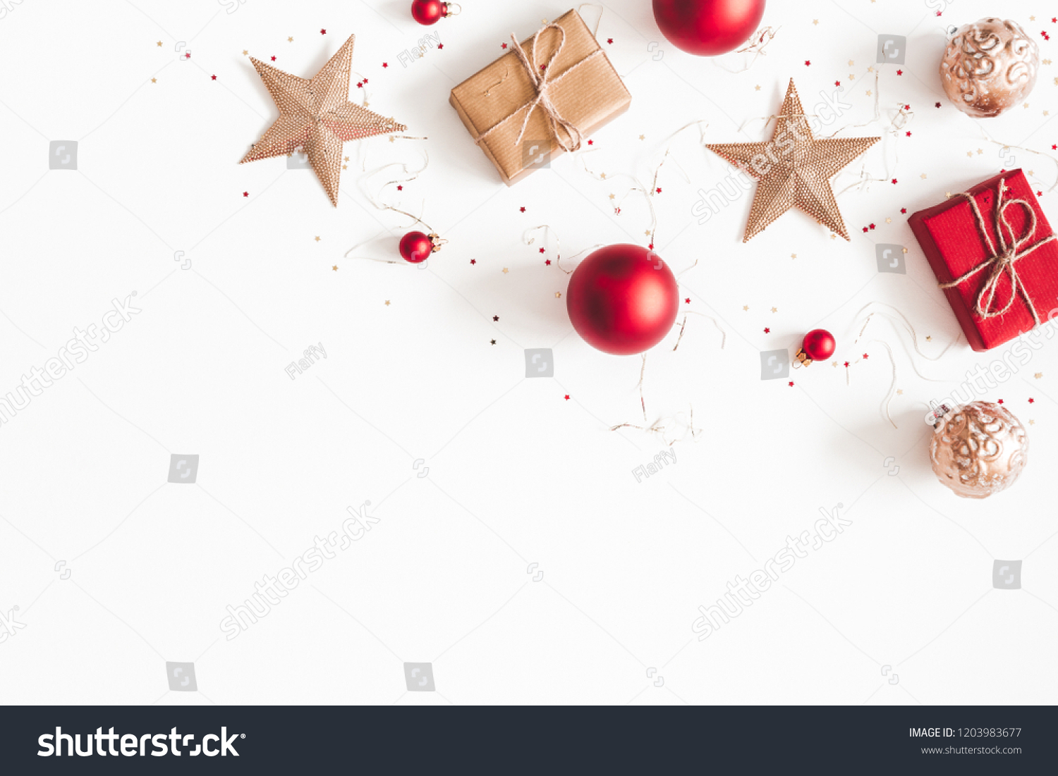 Christmas composition. Christmas gifts, red and golden decorations on white background. Flat lay, top view, copy space #1203983677