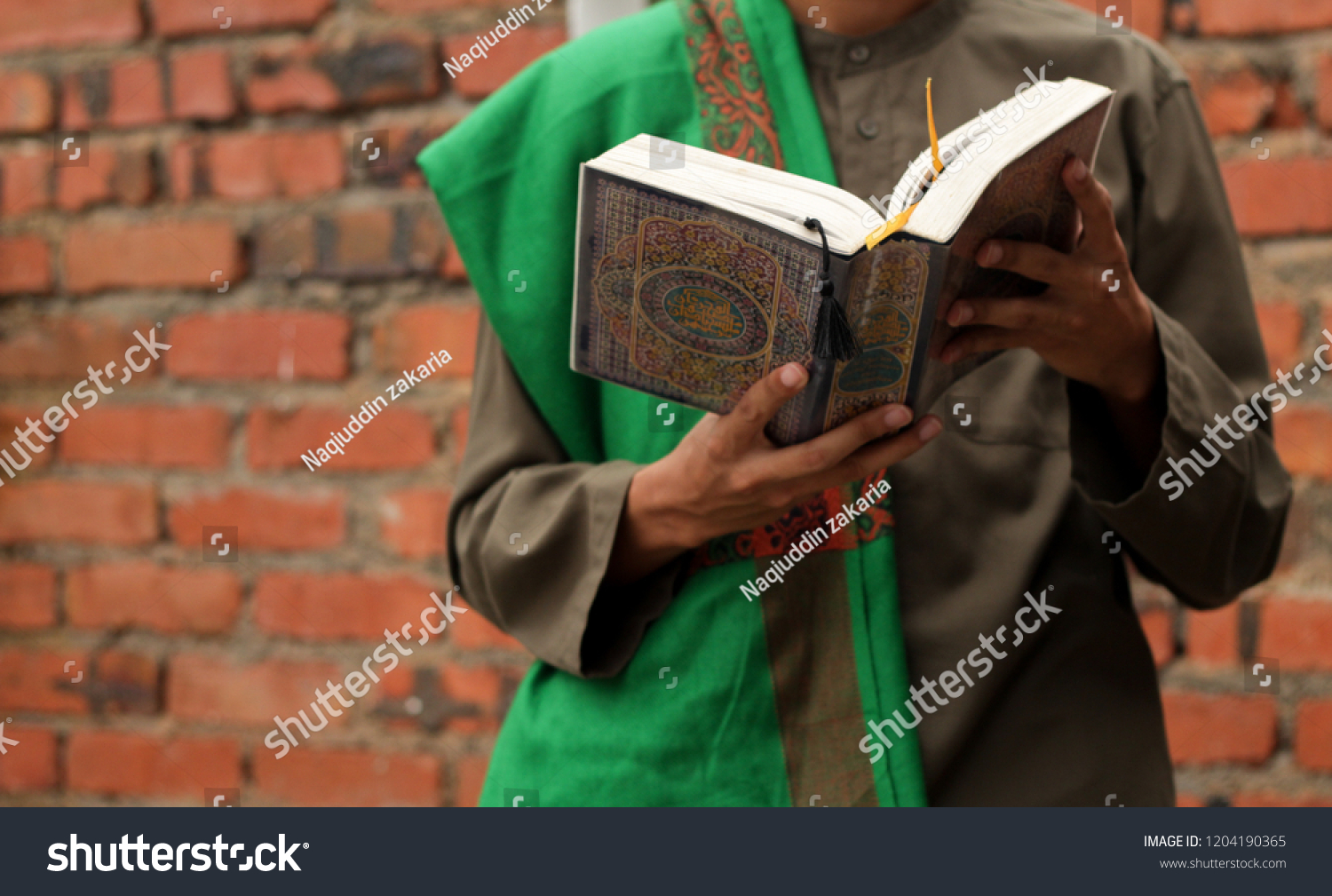 Quran Hold By Hand Blurred Background Stock Photo (Edit Now) 1204190365
