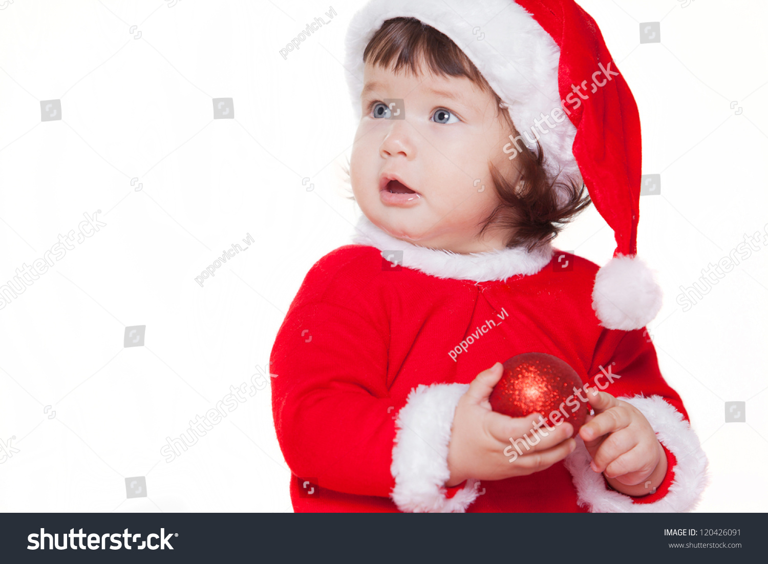 29e7fb66d63 Christmas happy baby in Santa hat playing with balls. Isolated on white  background.