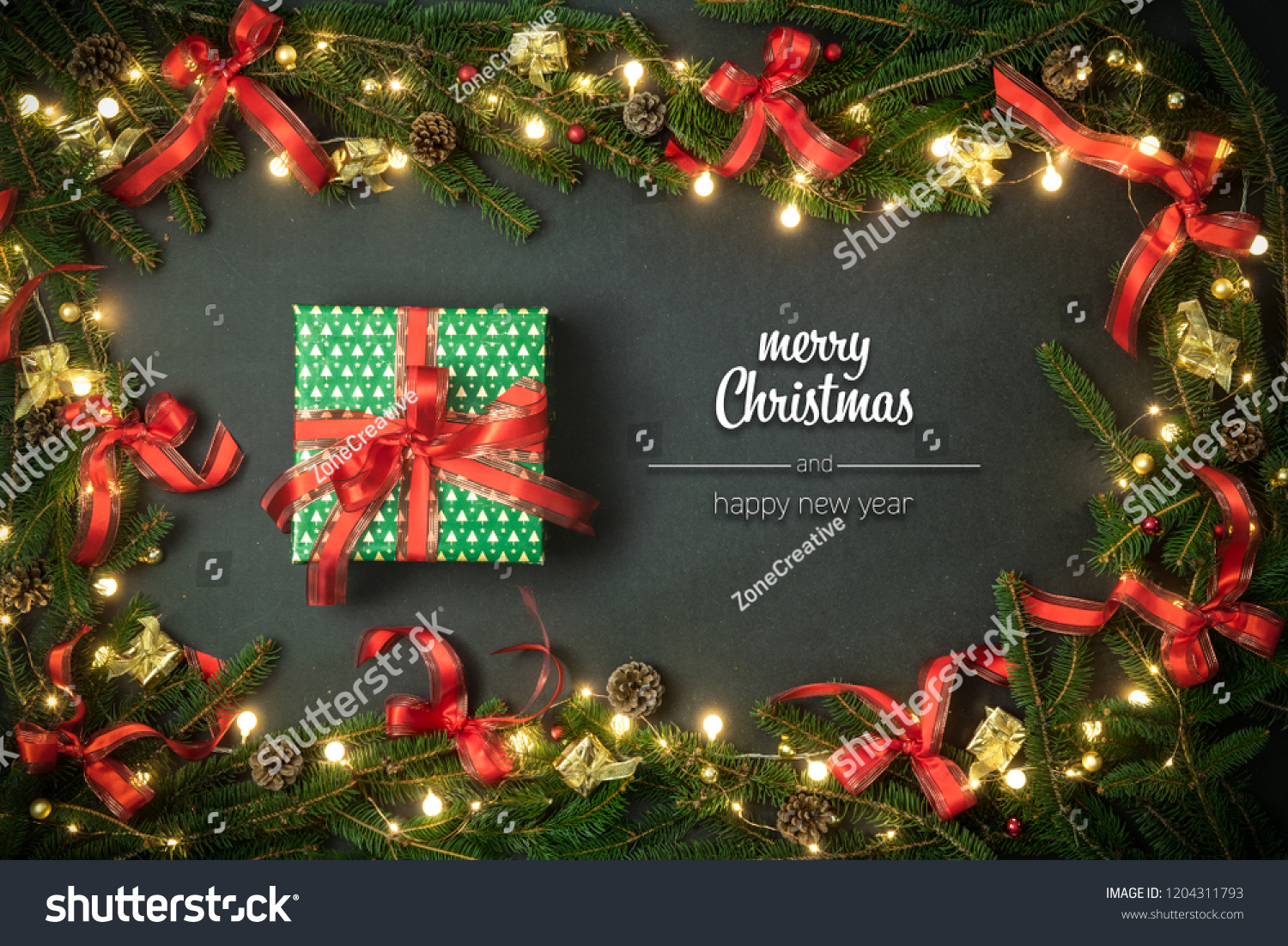 merry christmas and happy new year greetings in vertical top view dark blackboard with pine branches