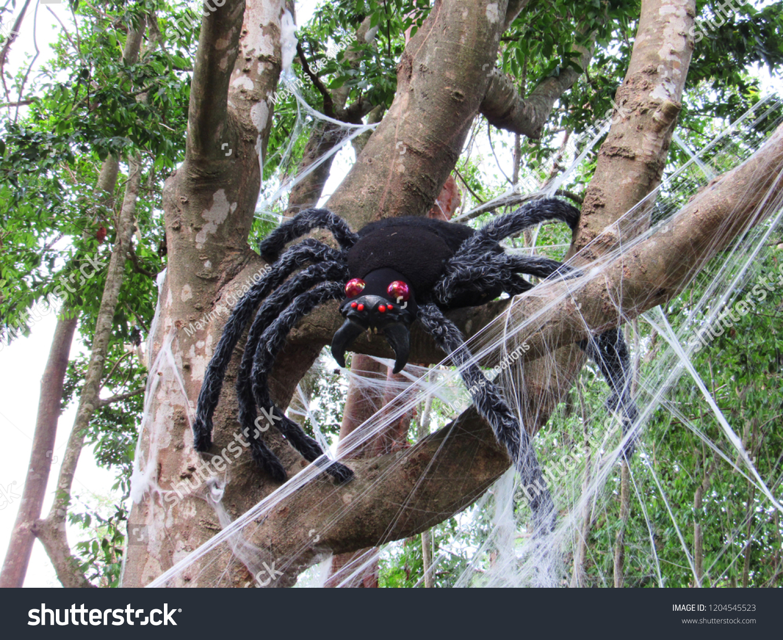Giant creepy black Spider on tree Halloween outdoor decoration