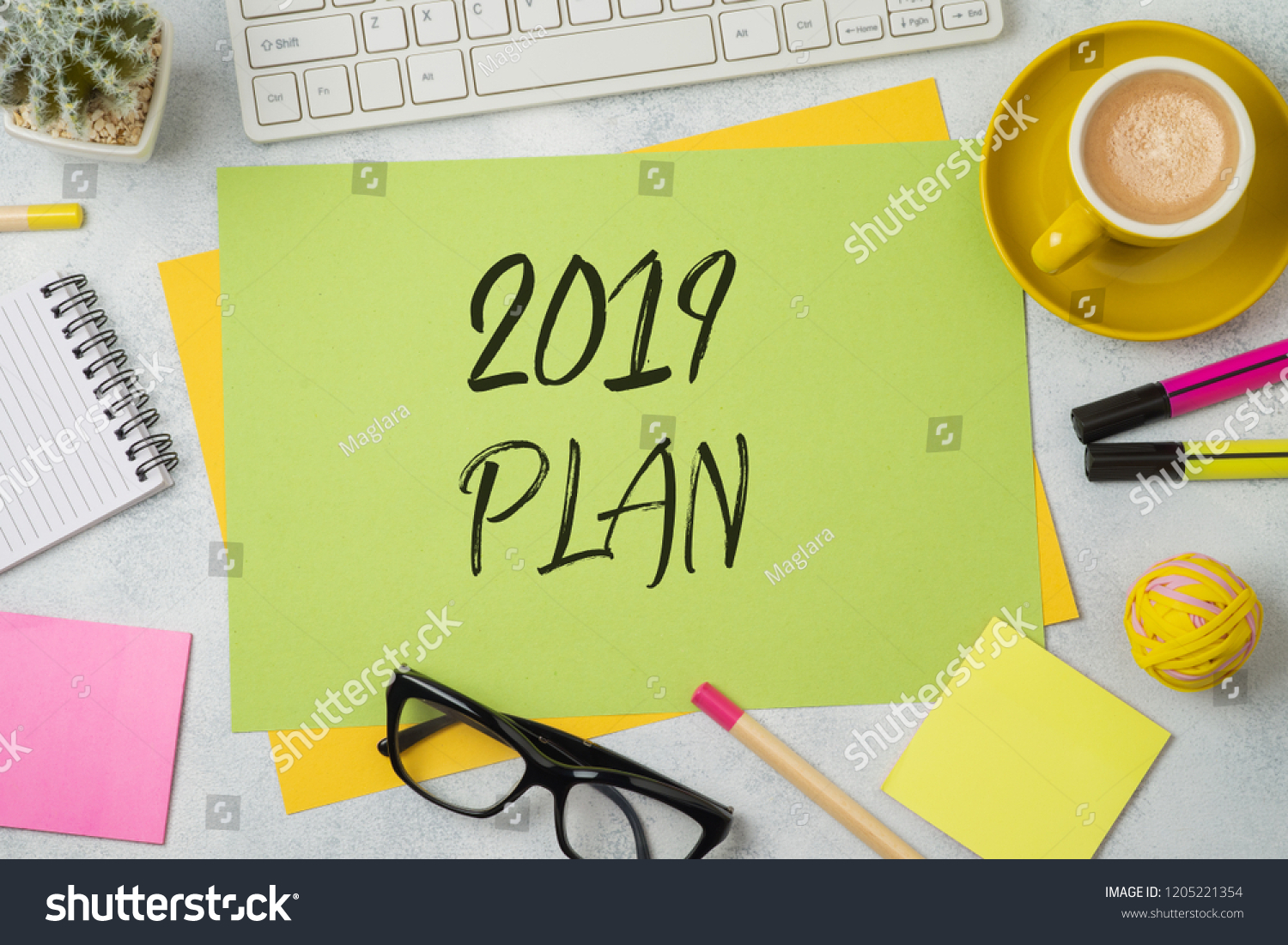 2019 plan text on colorful paper memo note with business office accessories. Top view from above #1205221354