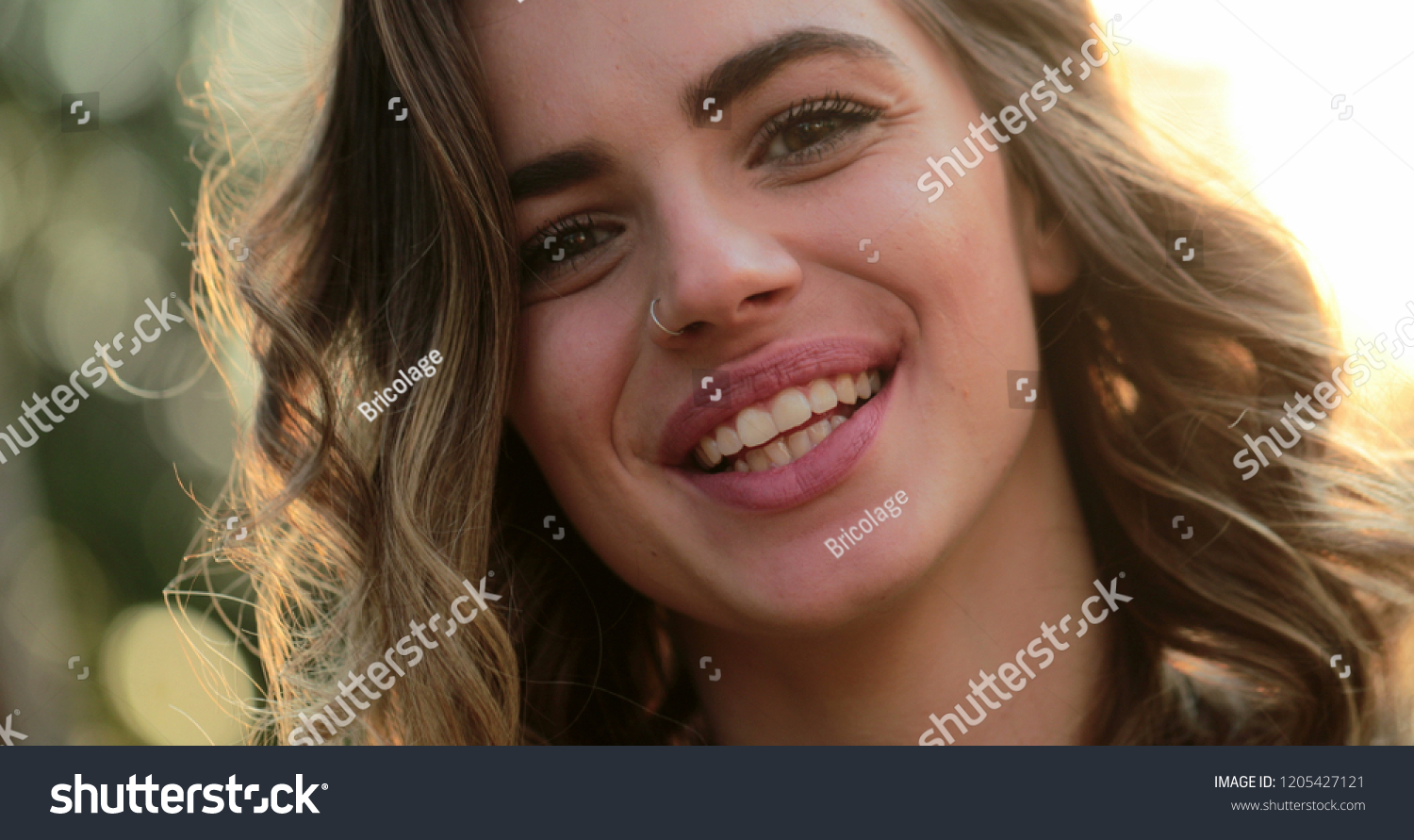 Hispanic latina girl smiling and laughing to camera. Portrait of young woman  looking to directly