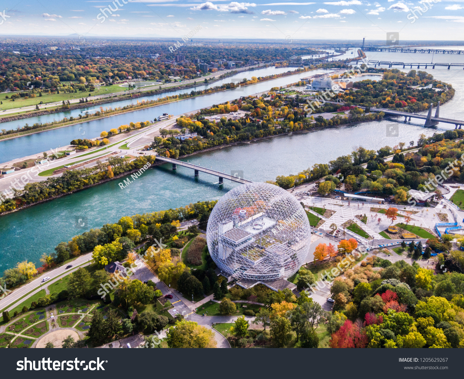 Aerial view of Montreal showing the Biosphere Environment Museum and Saint Lawrence River during Fall season in Quebec, Canada.  #1205629267