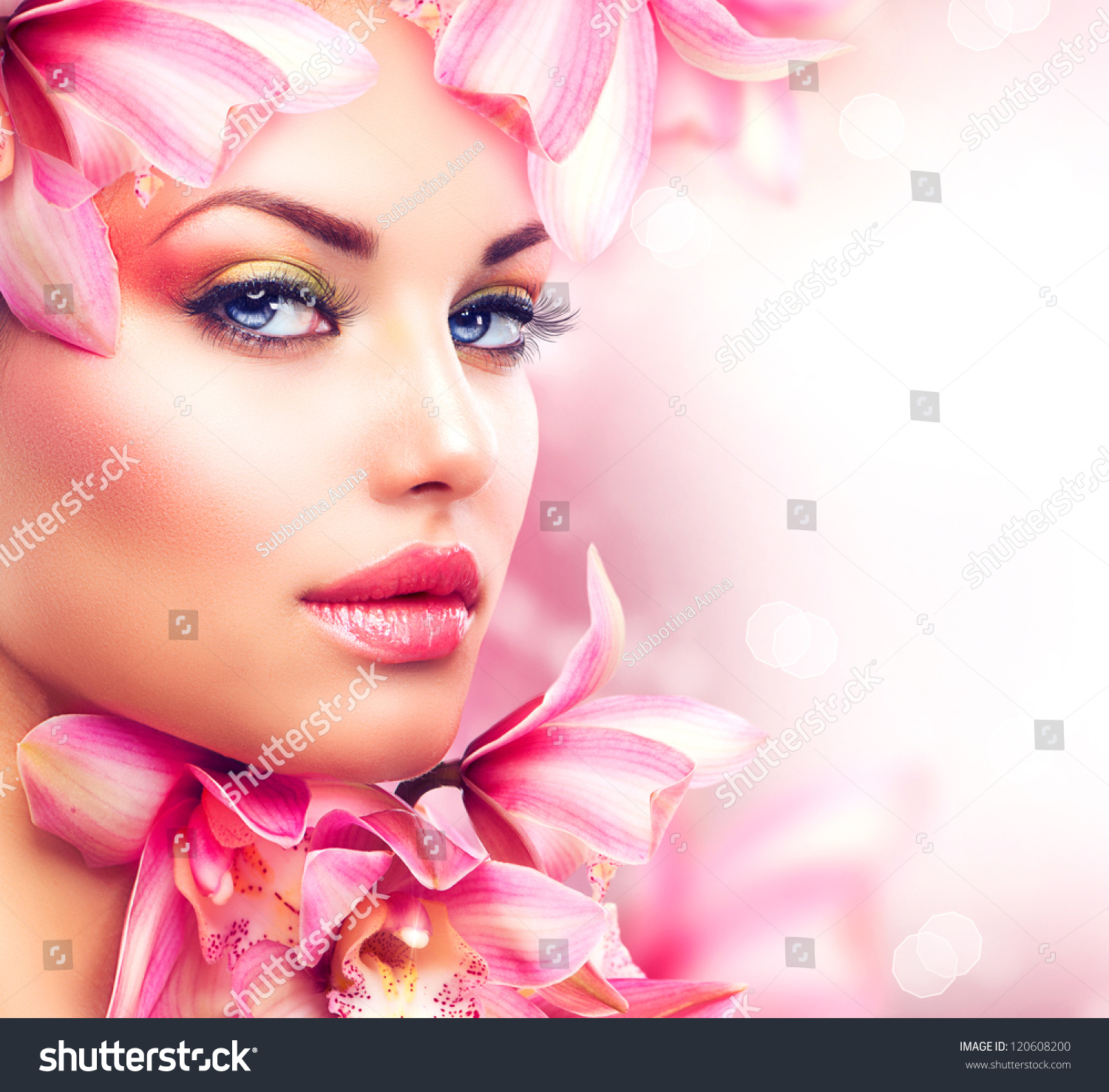 Beauty Girl With Orchid Flowers.Beautiful Model Woman Face
