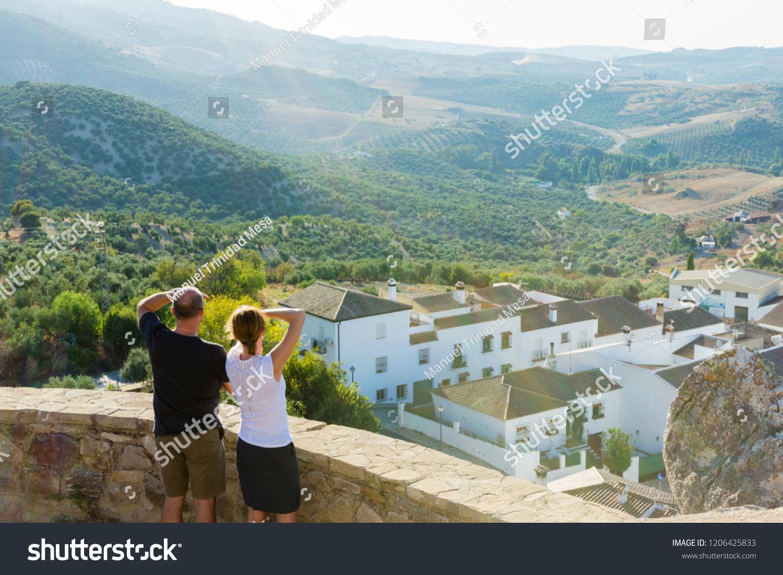 Viewpoint in Zahara de la Sierra, municipality of the province of Cádiz, Spain, couple observing nature.