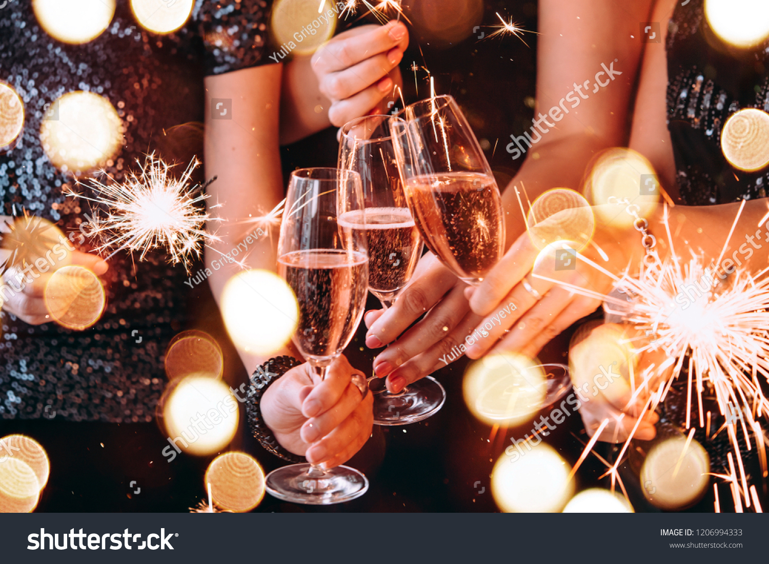 Friends celebrating Christmas or New Year eve party with Bengal lights and rose champagne. #1206994333