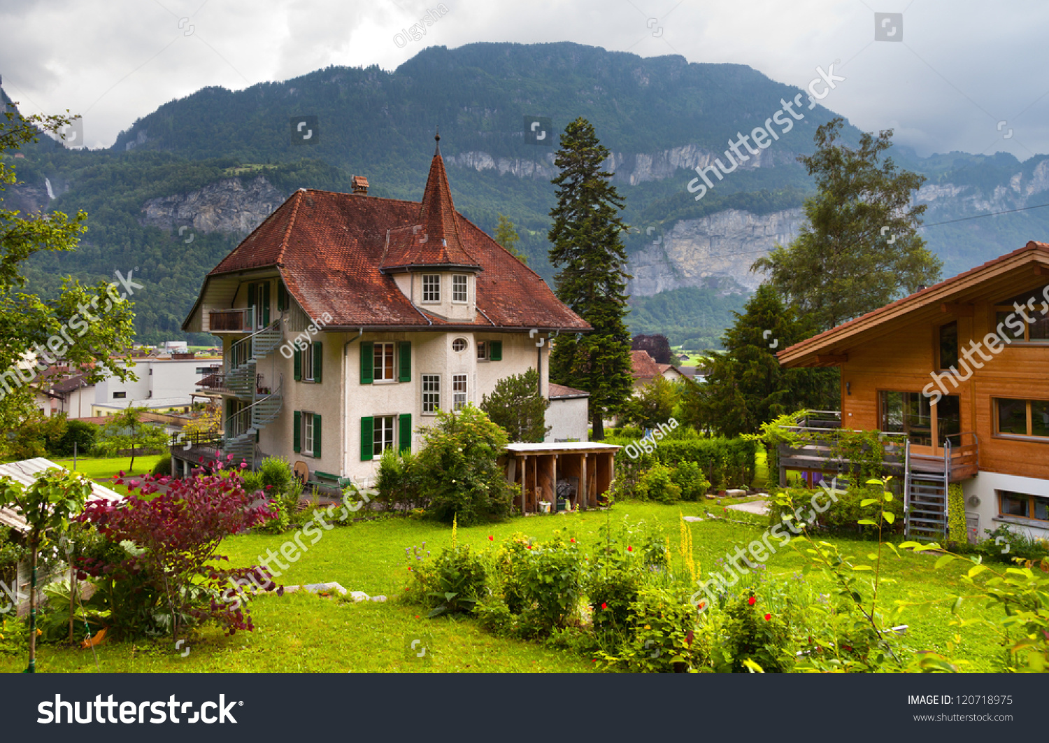 The Traditional Wooden Swiss Houses With A Garden