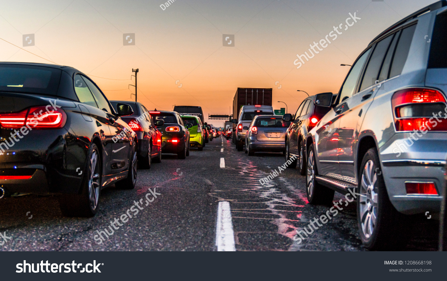 Vancouver, British Columbia - Canada. Traffic jam on a busy highway at rush hour. Cars in line, bumper to bumper, stuck in traffic at dusk on a clear sky night. #1208668198