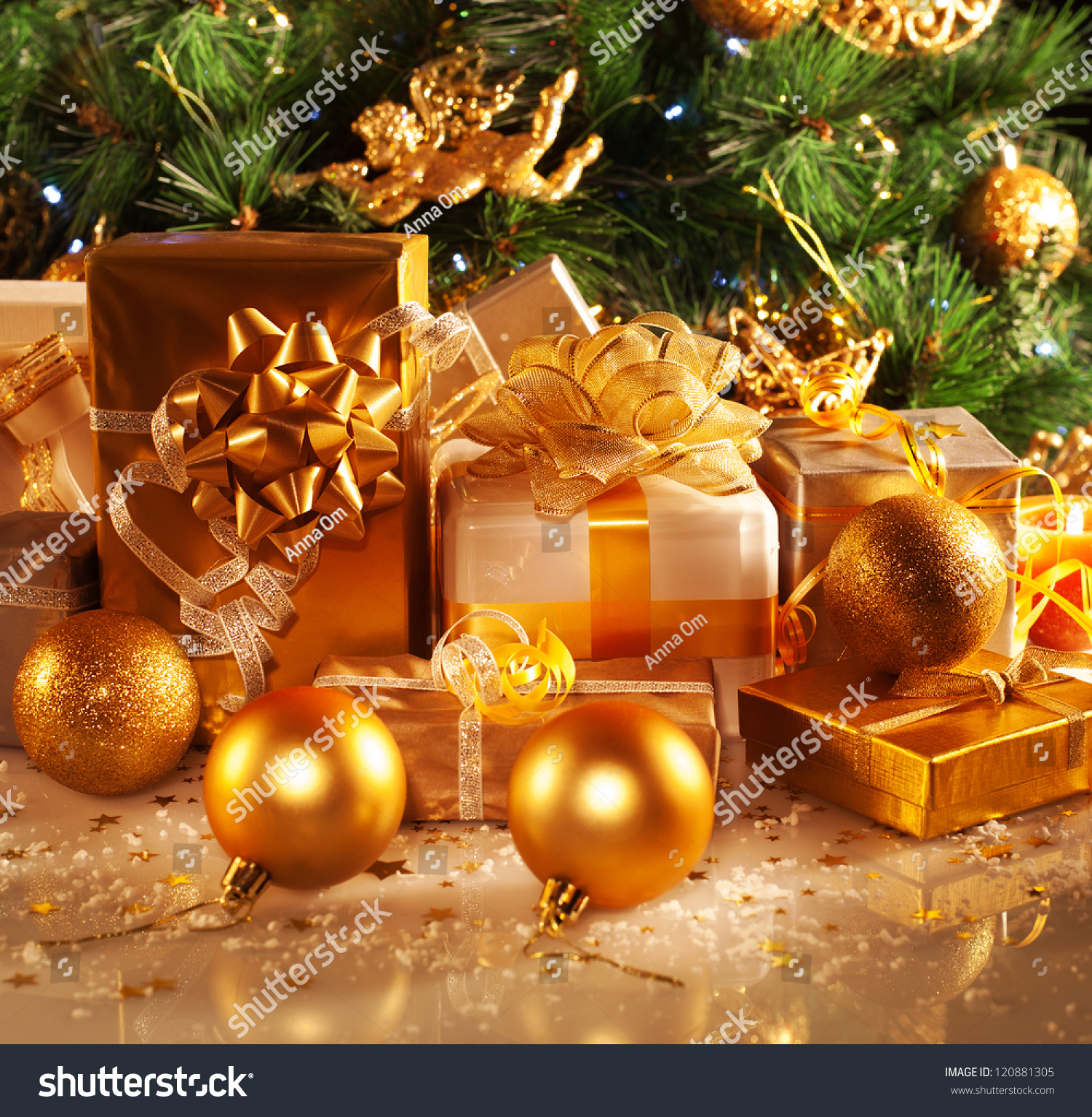 photo of luxury gift boxes under christmas tree new year home decorations golden wrapping