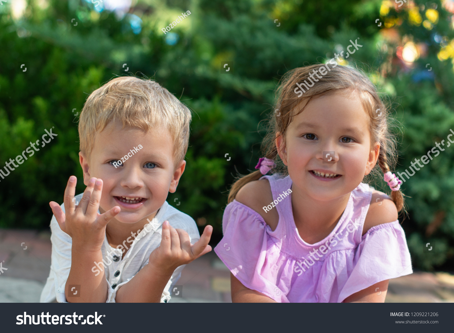 18a74ca4b2ed Waist up portrait of two cute little smiling children , boy and girl,  brother and