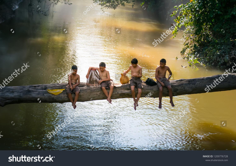 Lifestyle children countryside thailand children have fun stock