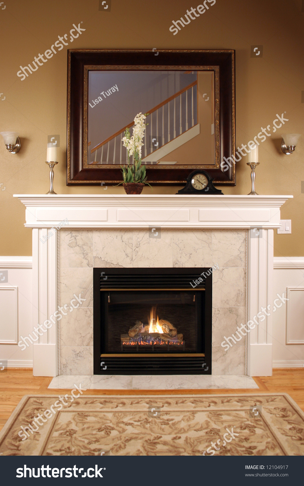 Fireplace With Beautiful Woodwork A Framed Mirror And Warm Inviting