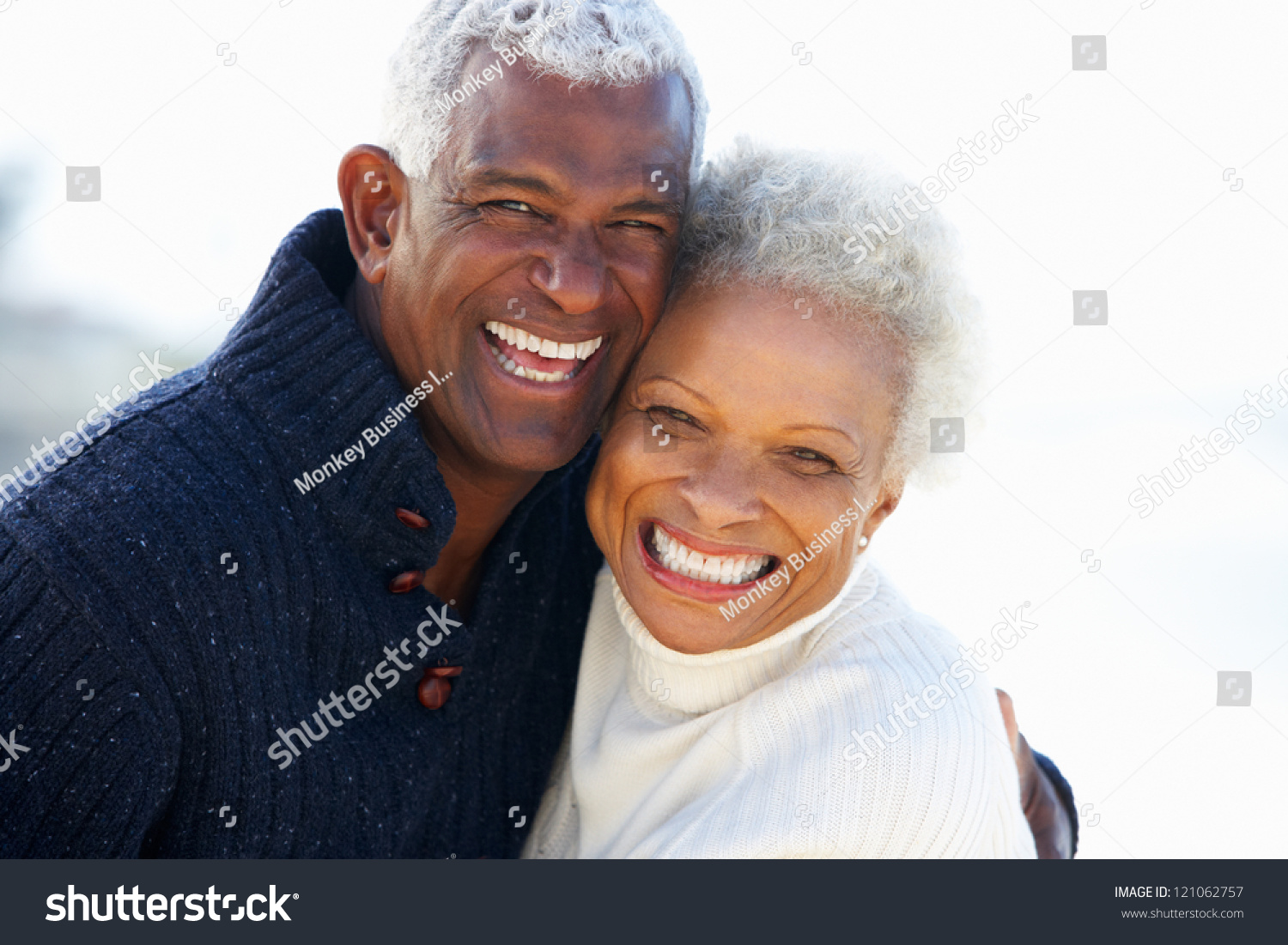 Romantic Senior Couple Hugging On Beach. Romantic Senior Couple Hugging On Beach Stock Photo 121062757