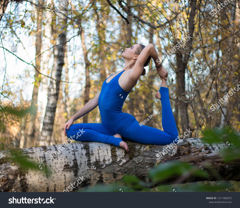 https://image.shutterstock.com/z/stock-photo-girl-sitting-on-the-tree-doing-stretching-1211482072.jpg