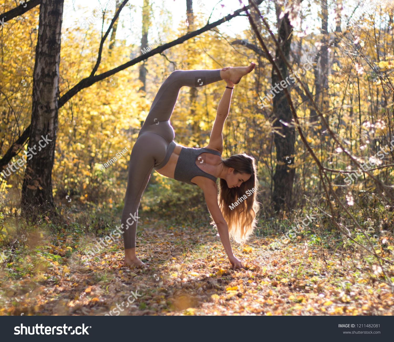 https://image.shutterstock.com/z/stock-photo-girl-doing-stretching-in-the-forest-1211482081.jpg