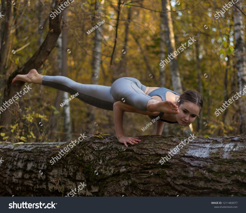 https://image.shutterstock.com/z/stock-photo-girl-doing-yoga-exercise-on-the-tree-1211483077.jpg