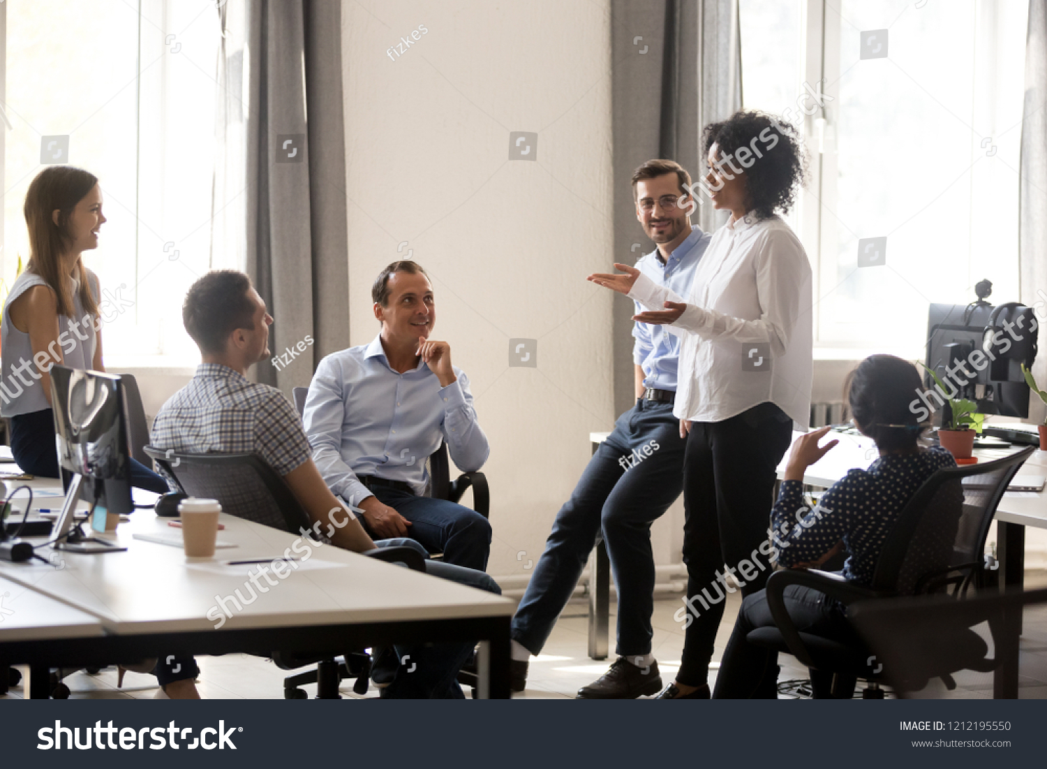 Smiling african manager coach speaking at diverse corporate group meeting, female black teacher team leader talking to office workers at training teaching employees explaining new idea, mentoring #1212195550