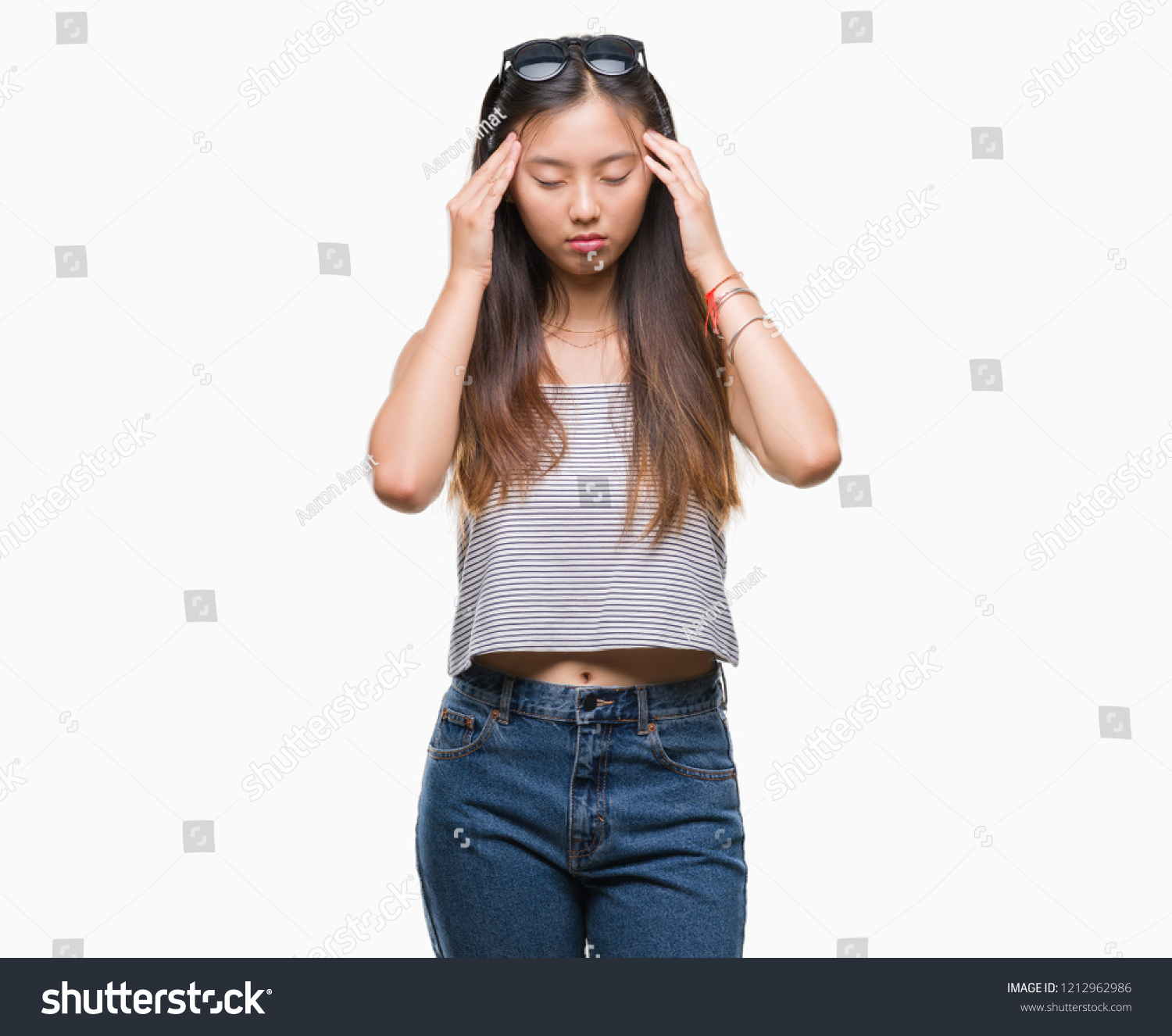 365f7d7f5d9 Young asian woman wearing sunglasses over isolated background with hand on  head for pain in head because stress. Suffering migraine. - Image