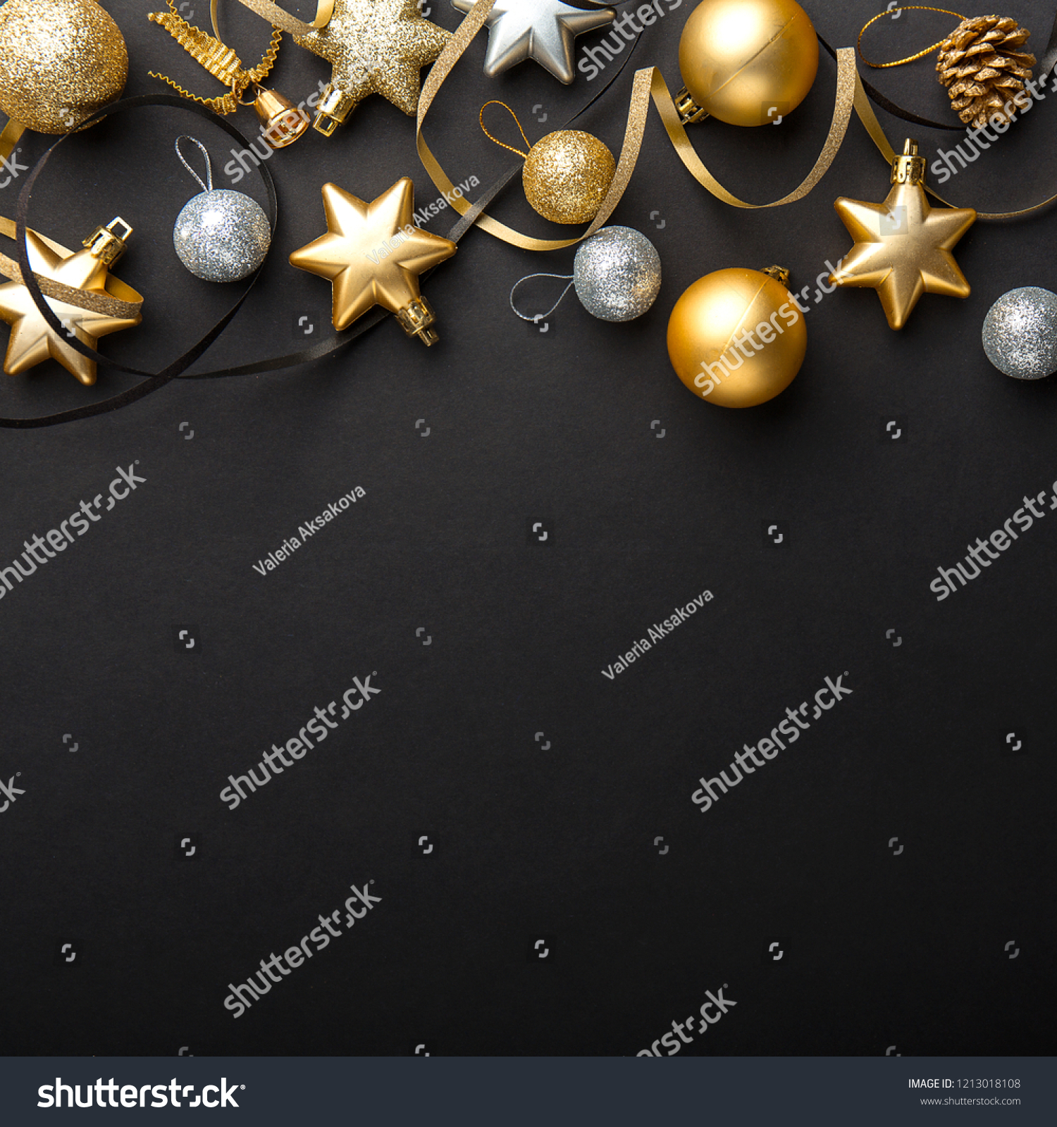Beautiful christmas golden silver deco baubles on dark black background. Flat lay design. Copy Space. Square format. #1213018108