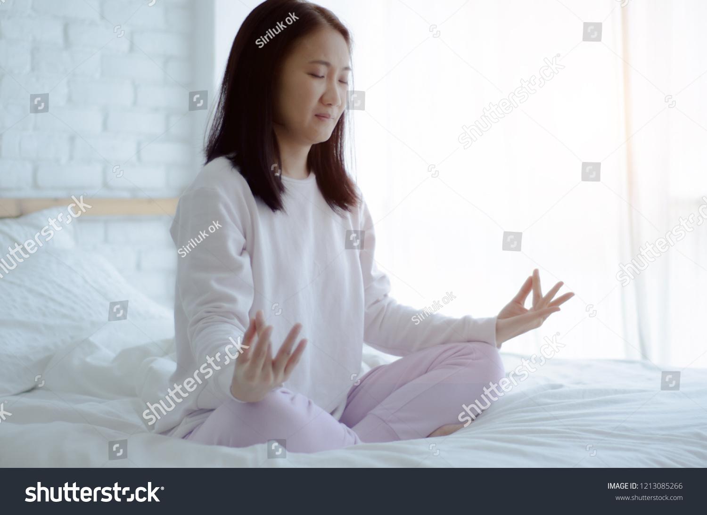 Asian Girls Sitting On Yoga Poses Stock Photo Edit Now 1213085266