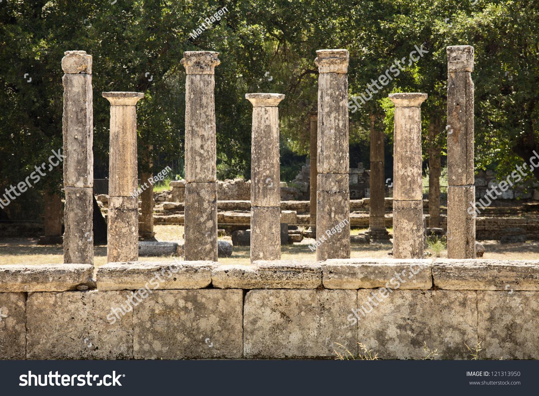 Ancient Stone Pillars : Row seven classic greek stone pillars stock photo