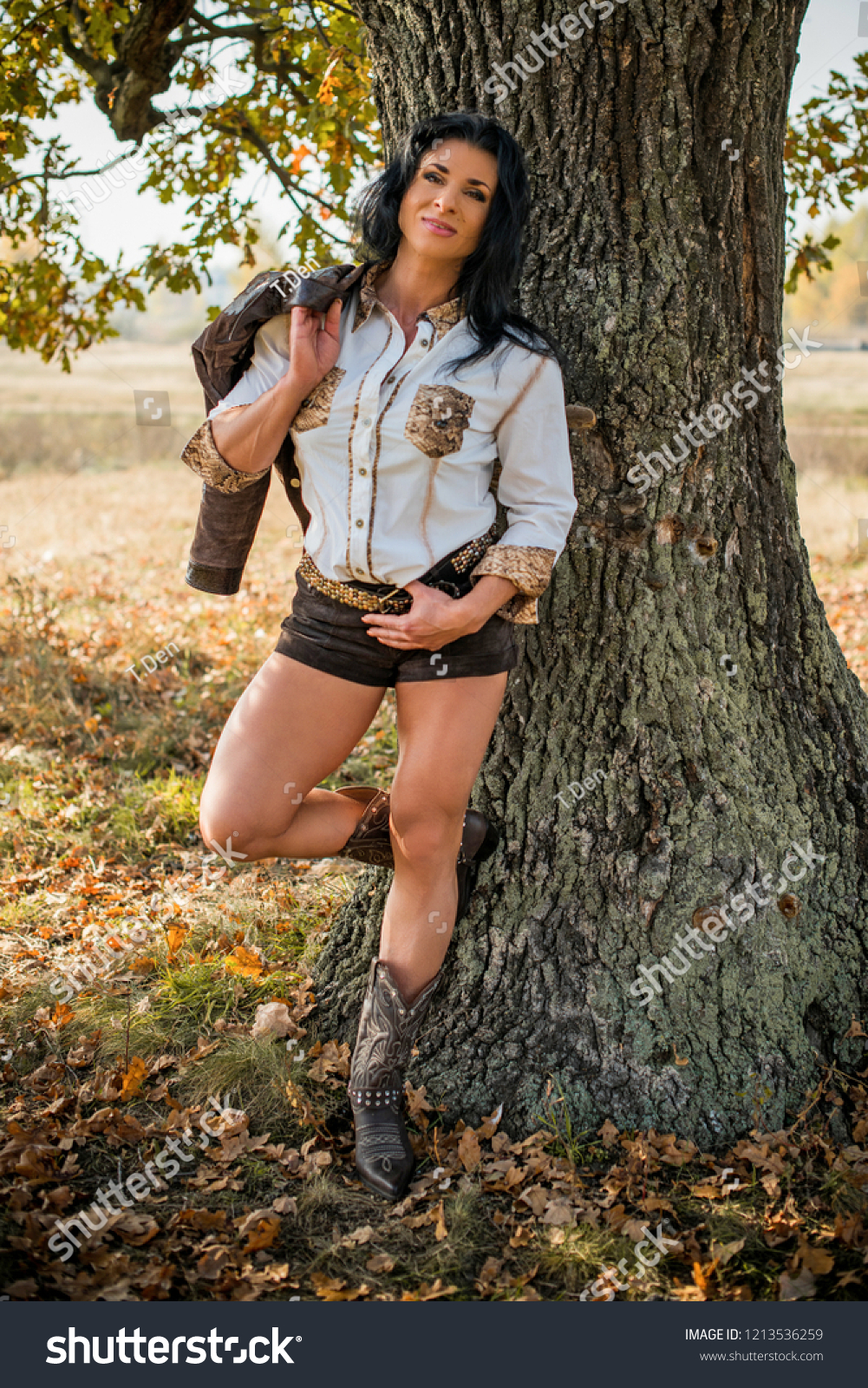 American mature fit woman in country style at nature. Fashionable american  clothes, pretty look