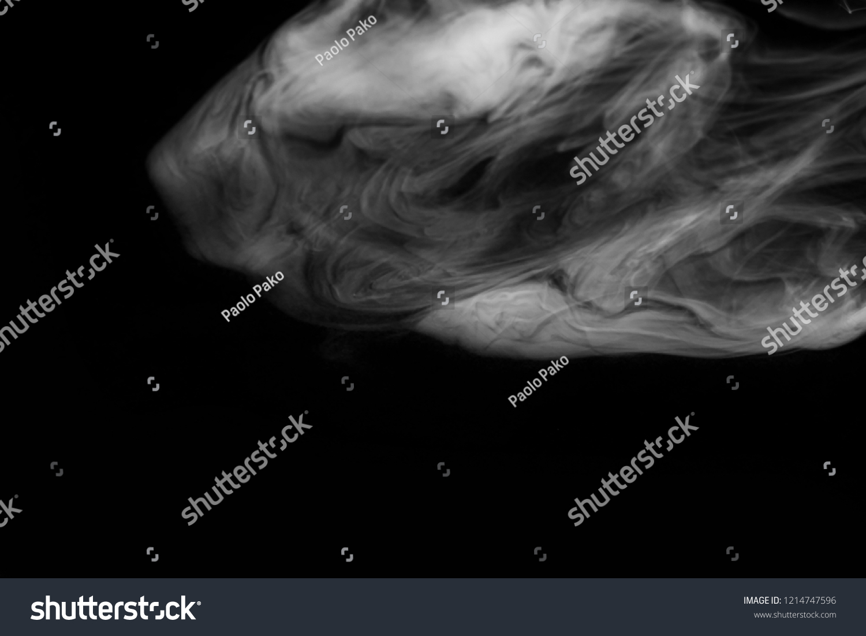 Stunning black and white cigarettes smoke effect on dark background