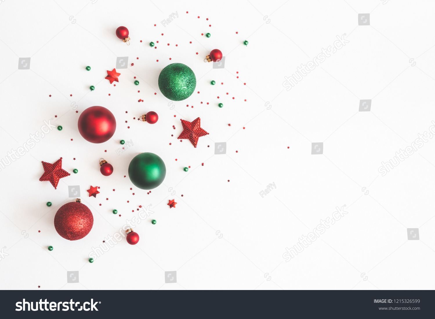 Christmas composition. Christmas red and green decorations on white background. Flat lay, top view, copy space #1215326599