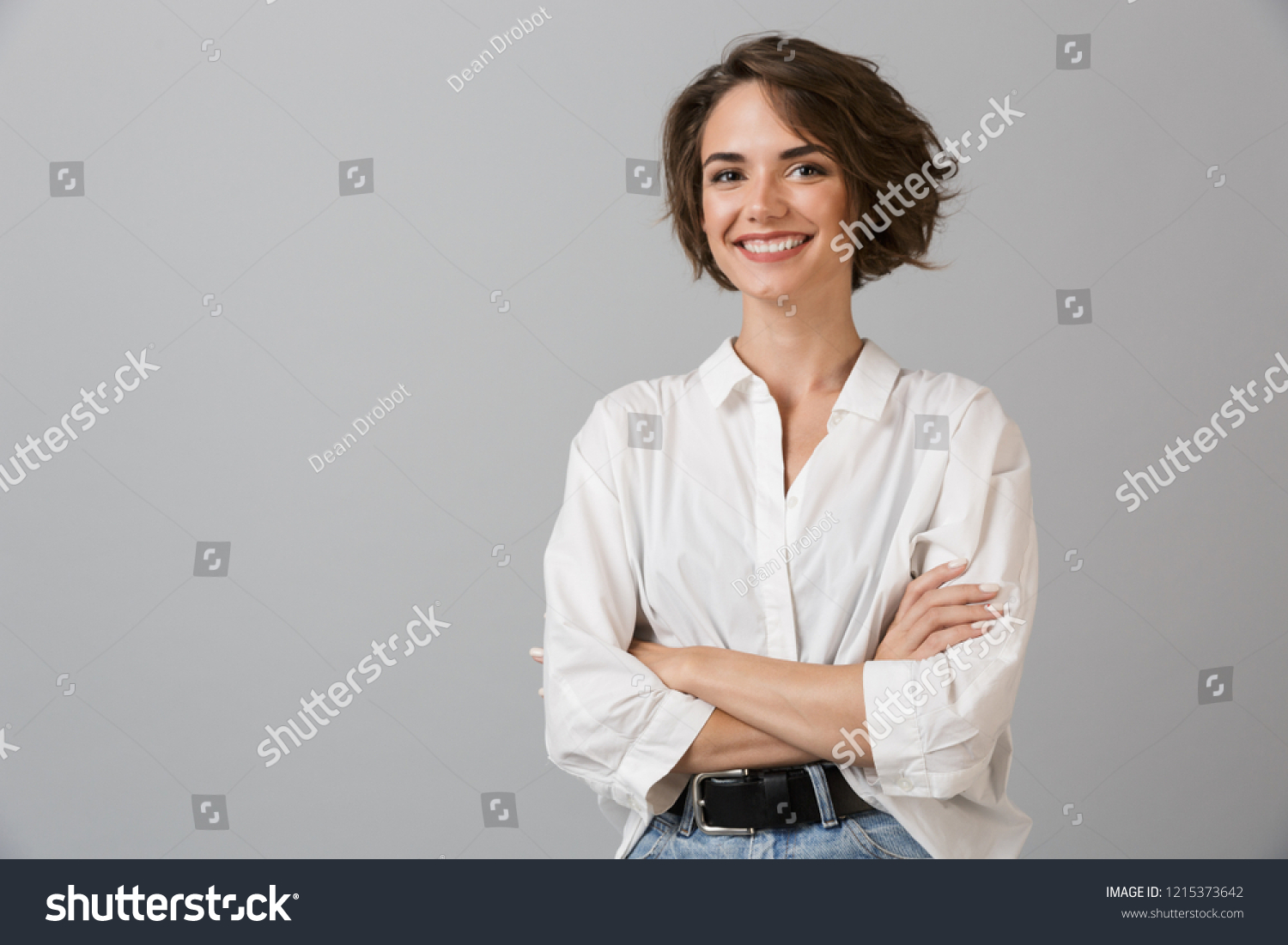 Image of happy young business woman posing isolated over grey wall background. #1215373642