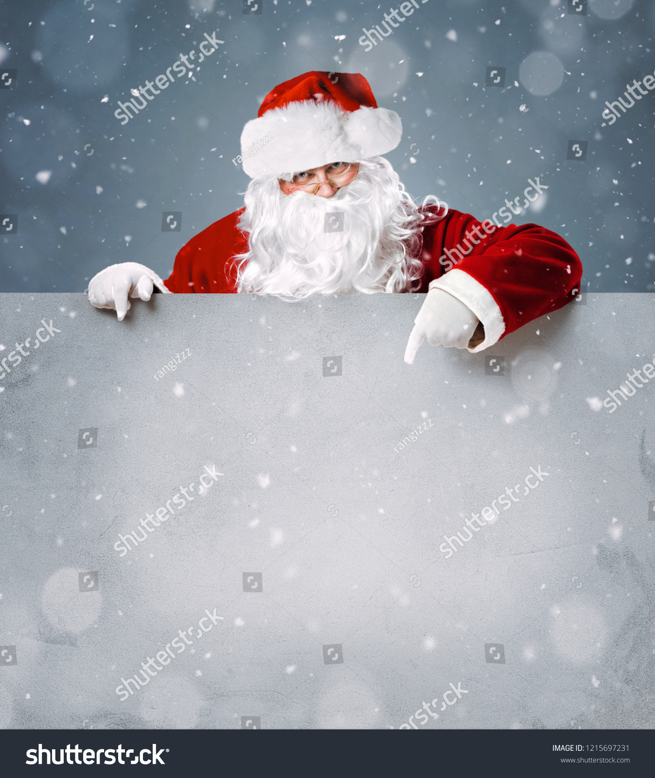 Santa Claus pointing in blank advertisement banner with copy space #1215697231