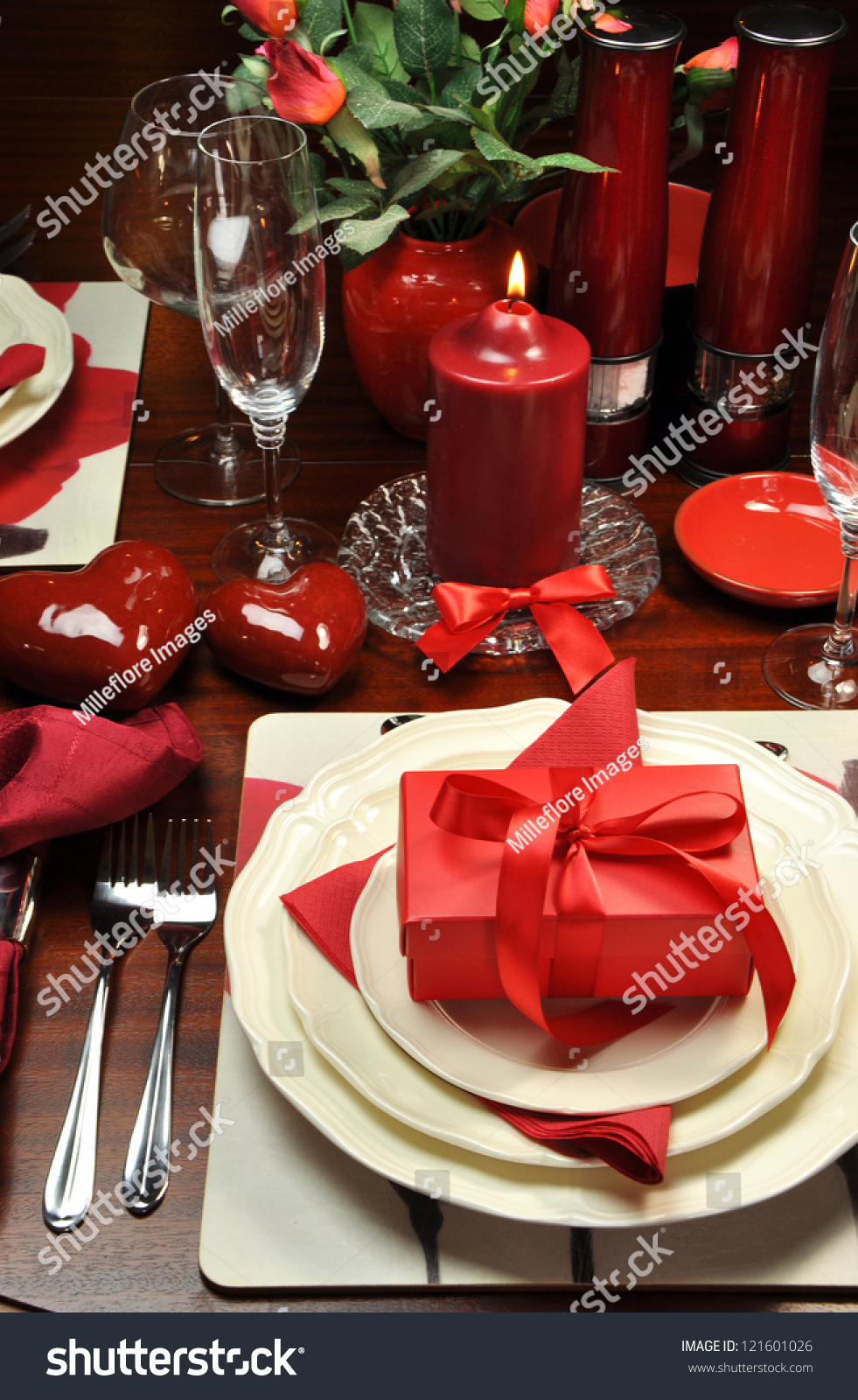 How to set a romantic dinner table for two - Red Valentine Romantic Dinner For Two Table Setting With Gift Candle And Hearts Vertical