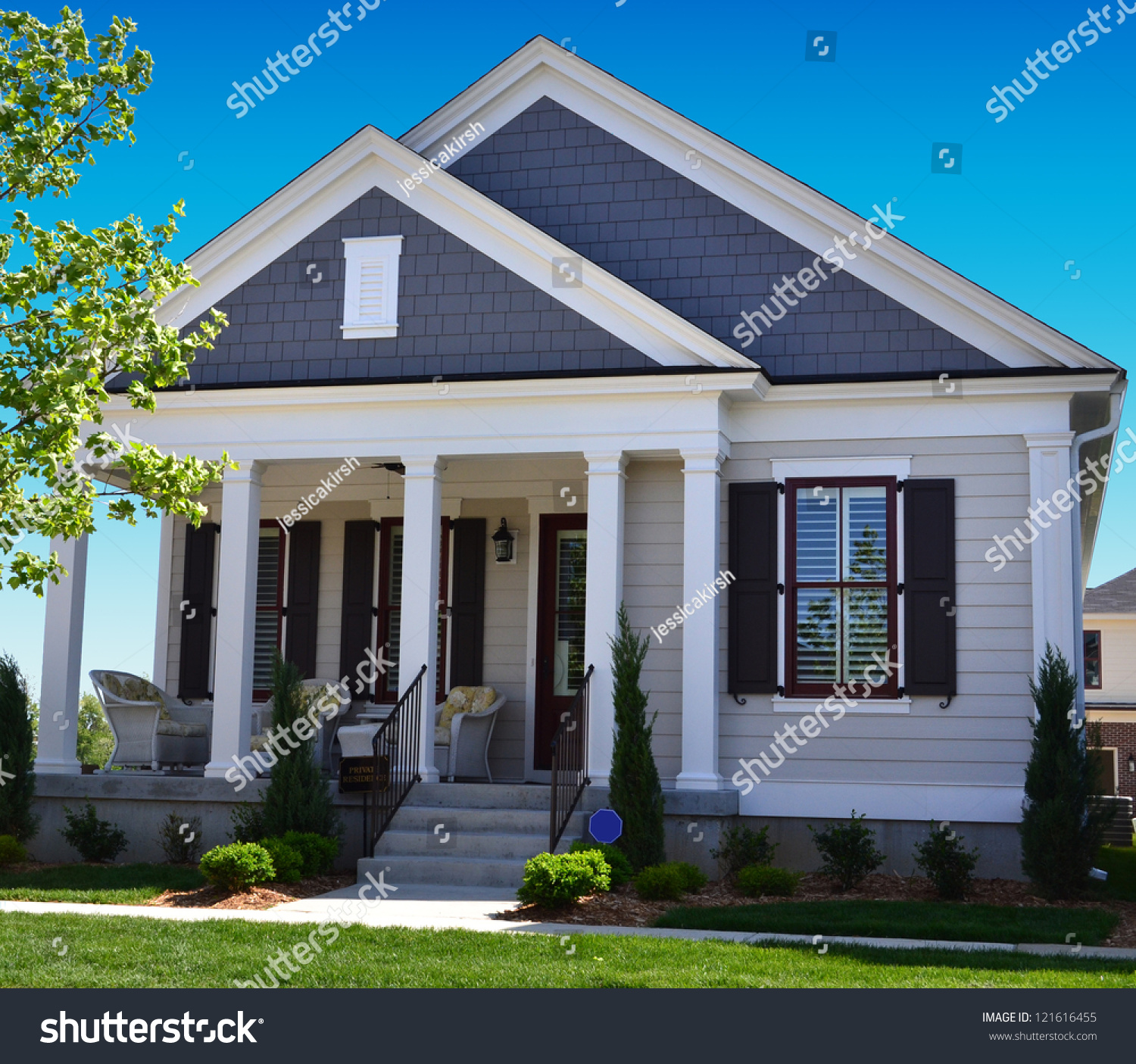 Blue white suburban american cape cod stock photo Portico on cape cod house