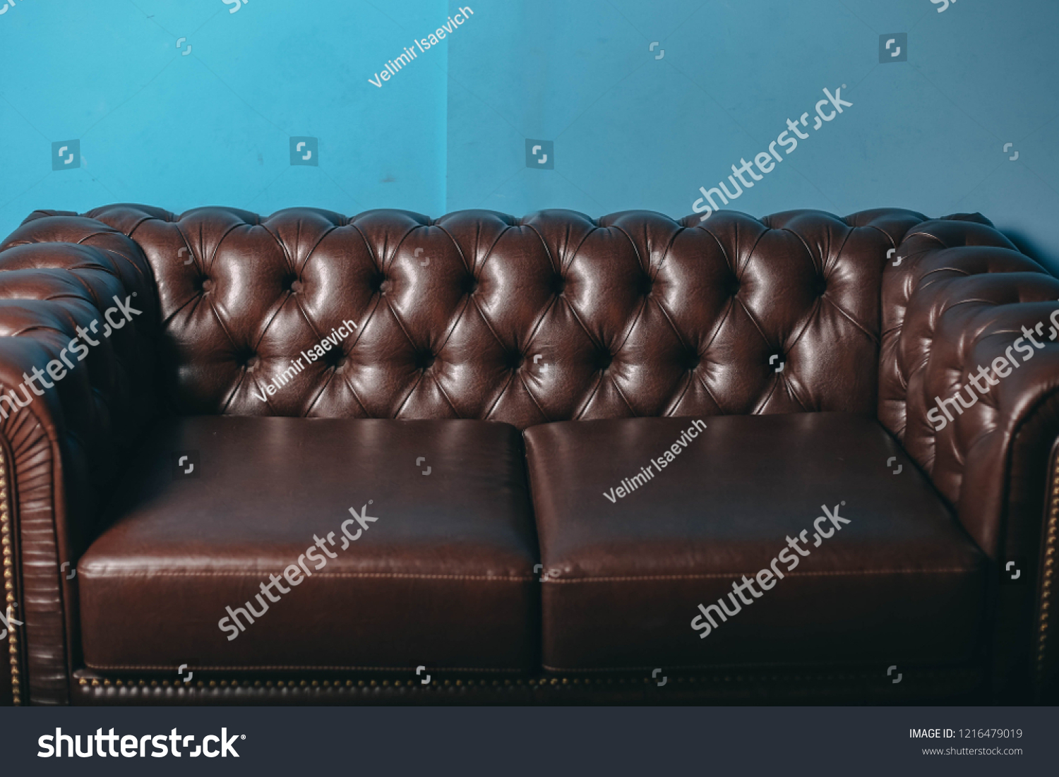 Picture of: Luxurious Leather Brown Sofa Blue Wall Stock Photo Edit Now 1216479019