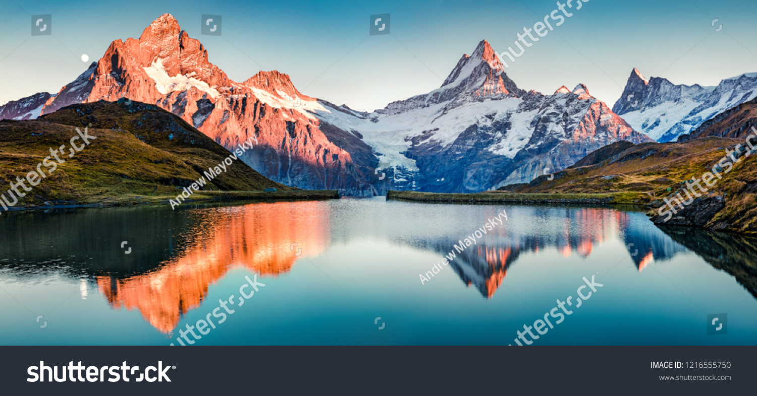 Fantastic evening panorama of Bachalp lake / Bachalpsee, Switzerland. Picturesque autumn sunset in Swiss alps, Grindelwald, Bernese Oberland, Europe. Beauty of nature concept background. #1216555750